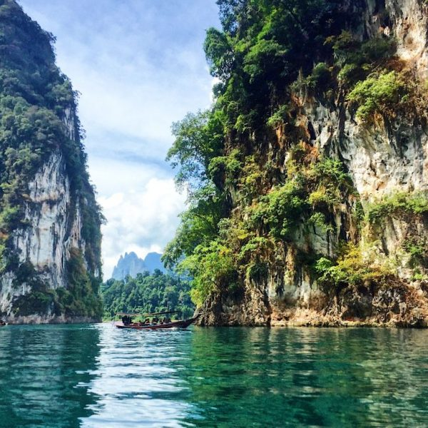 Boat sitting on Cheow Lan Lake in Khao Sok National Park Thailand