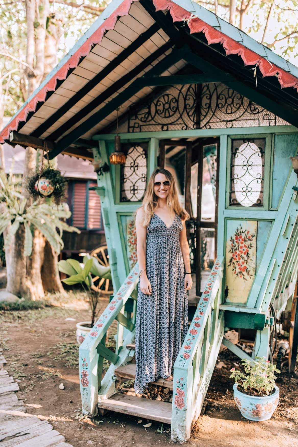 Hannah Corderman standing on a step at a Bali beach bar - Wanderlight Moments - We Are Travel Girls - Travel Blogger