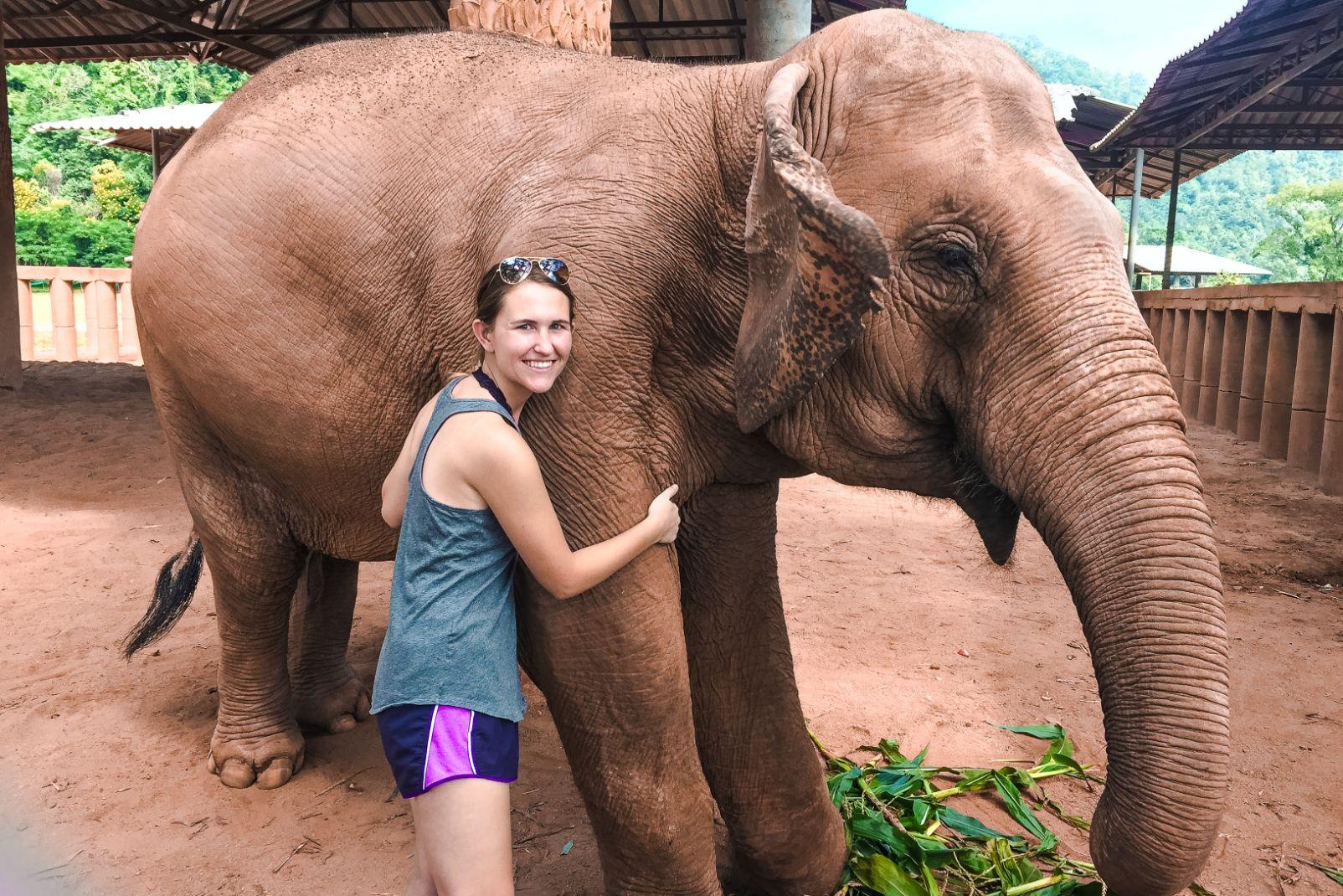 Hannah Corderman hugging elephant at Elephant Nature Park north of Chiang Mai Thailand