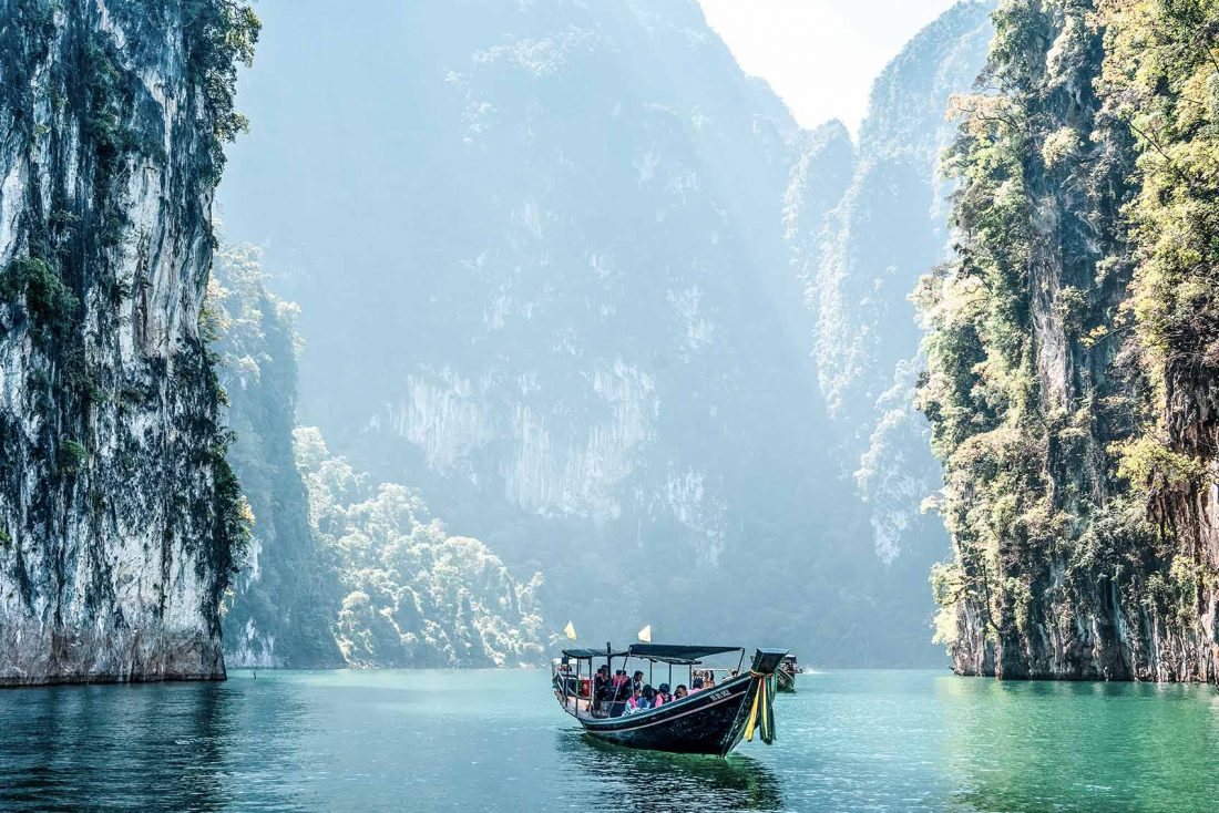 Boat on water in Khao Sok National Park Thailand - bucket list travel