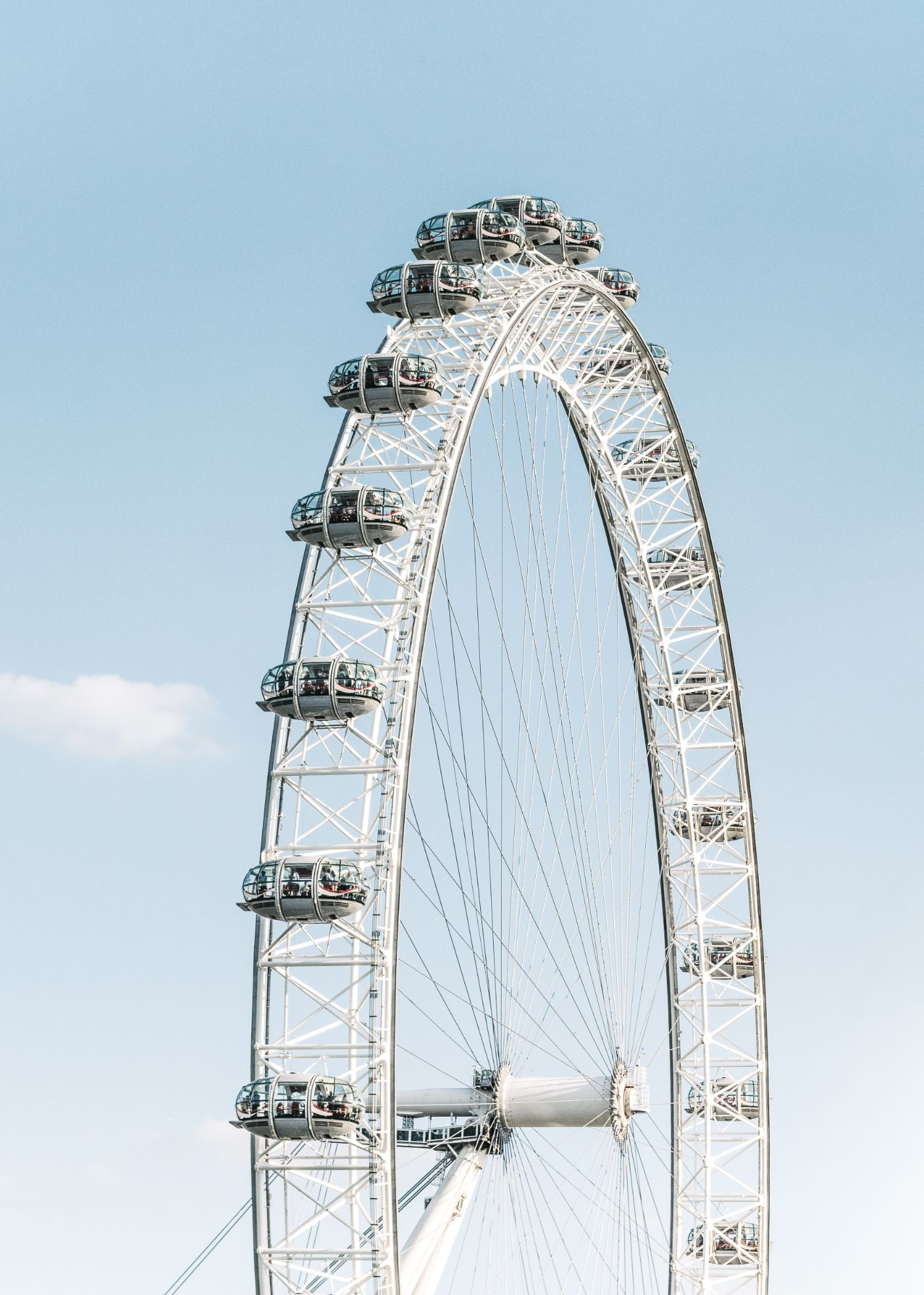 London Eye wheel with blue sky in the background