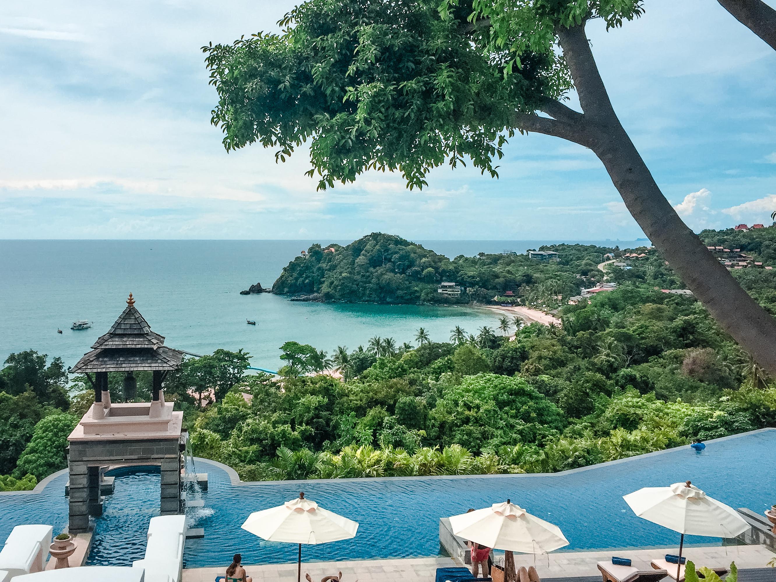 Pimalai Resort and Spa pool overlooking trees and ocean in Ko Lanta Thailand