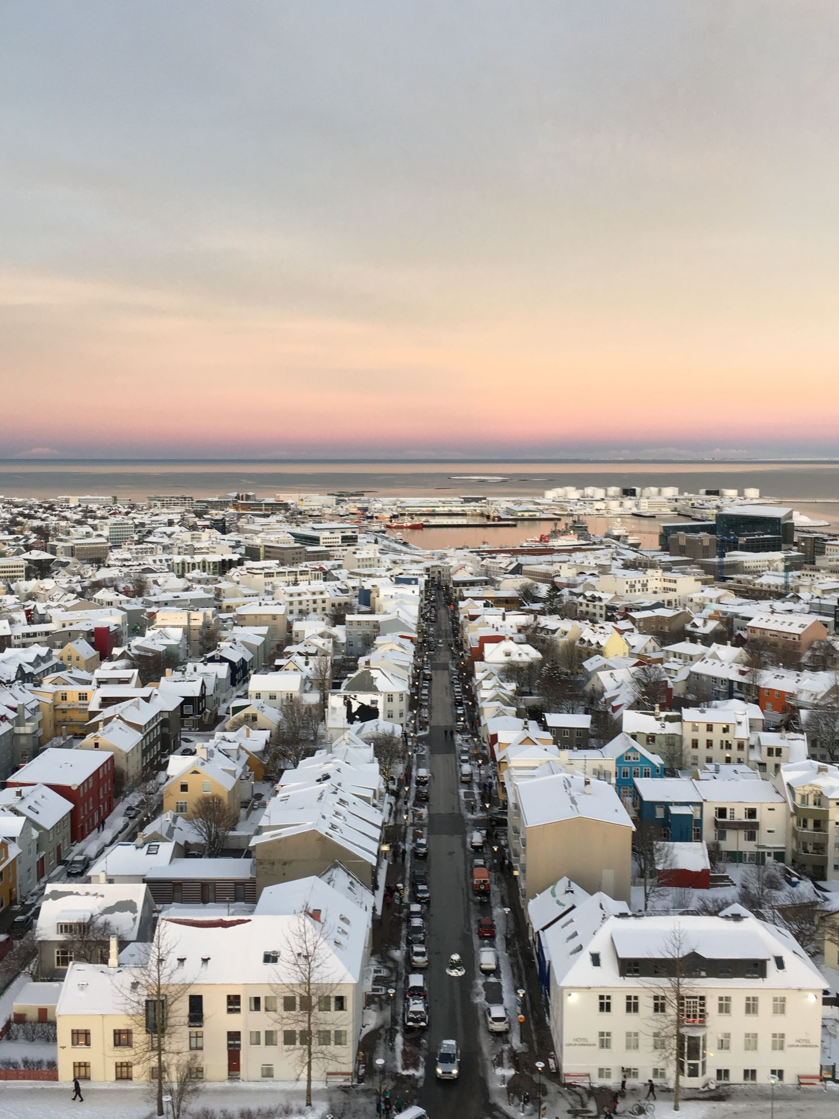 Aerial view of city of Reykjavik Iceland in the wintertime as the sun sets in the background - stop in 24 hour Iceland itinerary