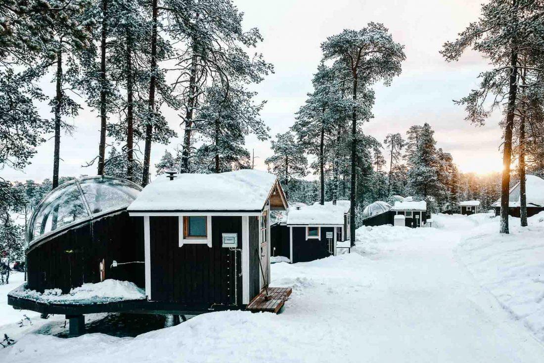 glass igloos in Finnish Lapland snow - bucket list travel