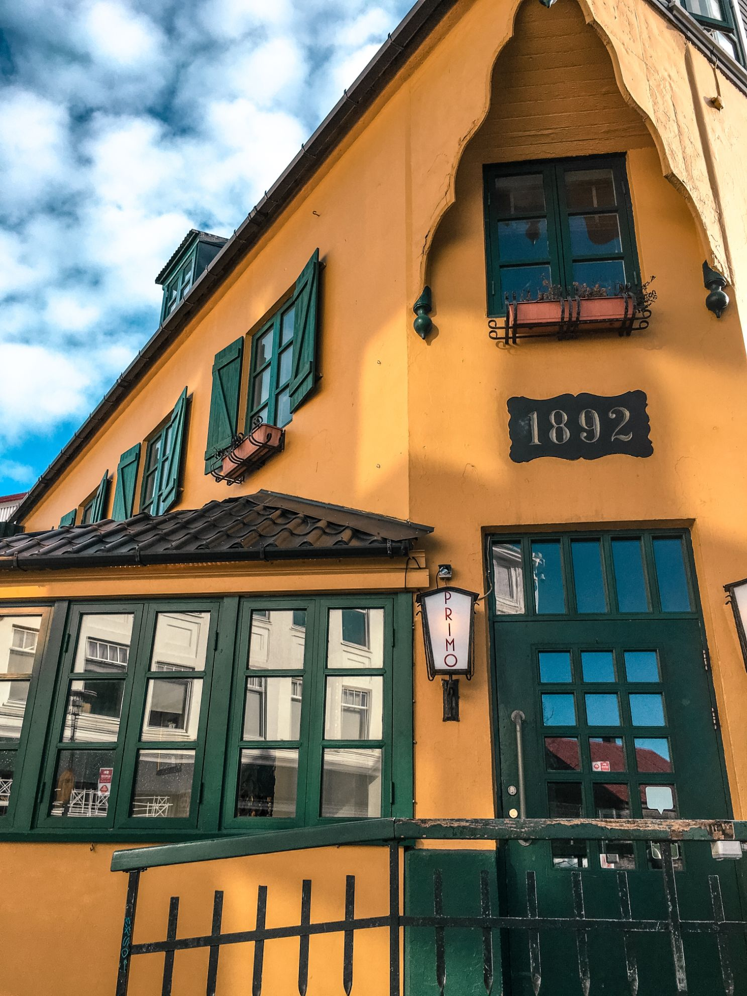 Exterior of Primo Ristorante in downtown Reykjavik Iceland with a sign that reads 1892 over the doorway - stop in 24 hour Iceland itinerary
