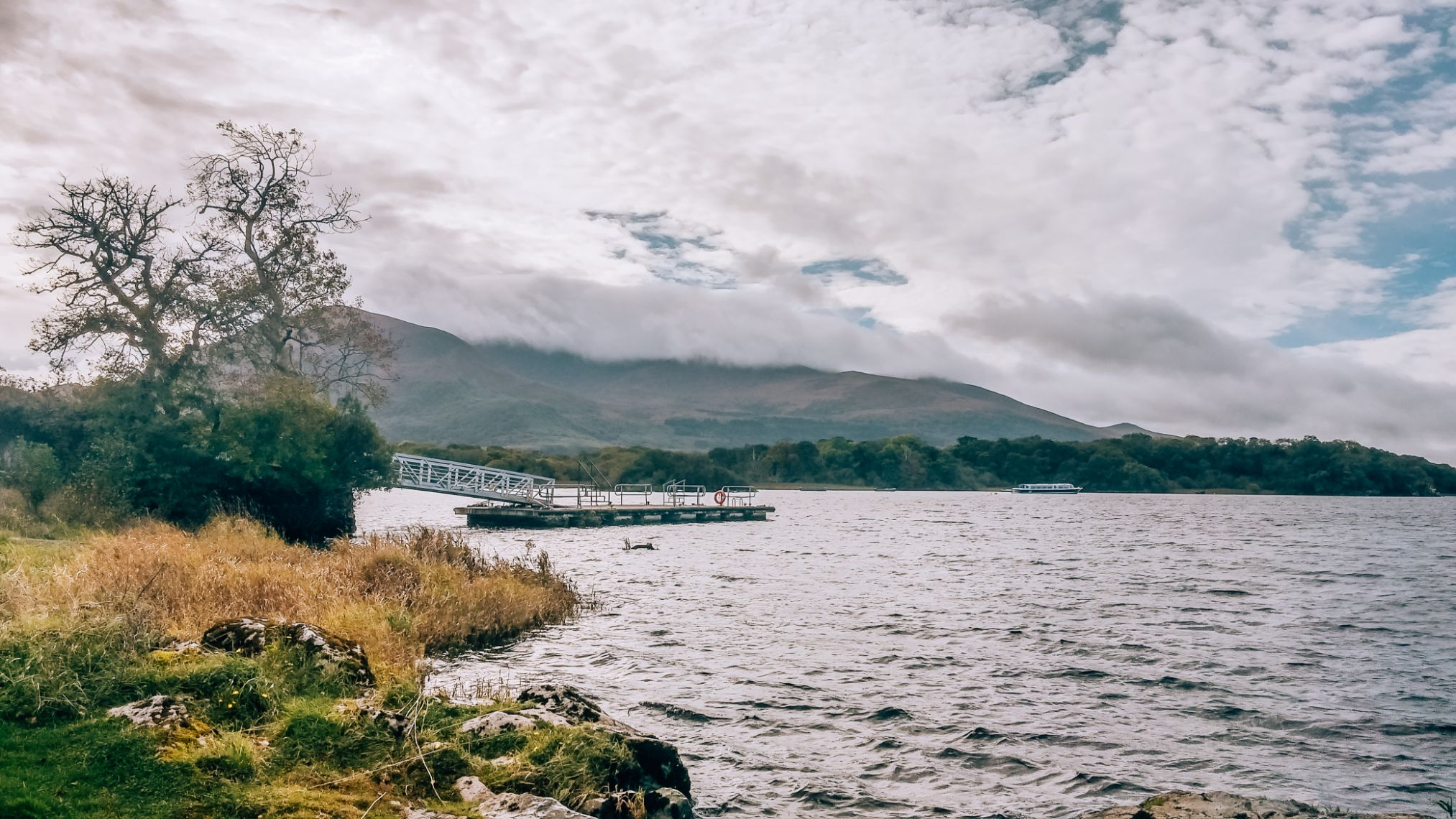 Lake at Killarney National Park Ireland with mountains in the background