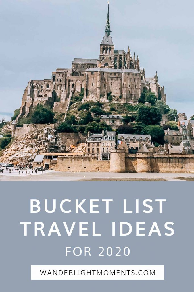 Pinterest graphic with image of Mont Saint-Michel in France and text that reads Bucket List Travel Ideas for 2020
