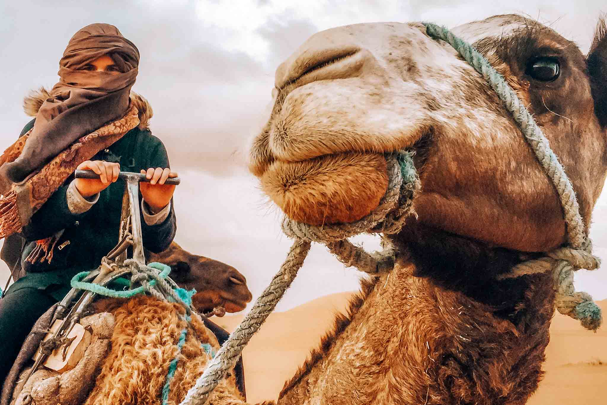 Hannah sitting on a camel in the Sahara Desert in Morocco
