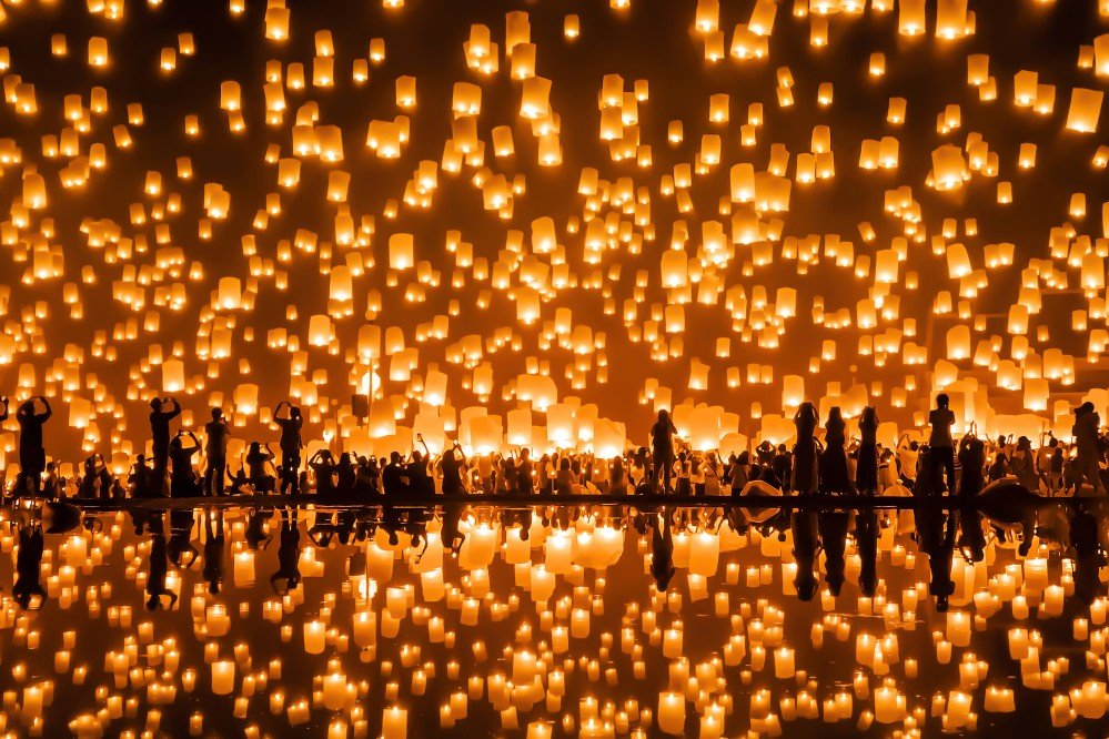 Thousands of lanterns floating into the night sky in Chiang Mai, Thailand
