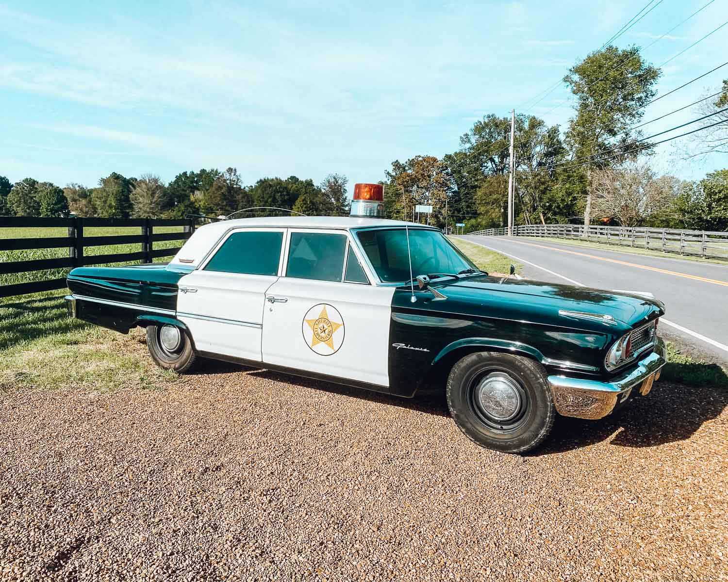 An old-fashioned cop car sitting on the side of the road in Leiper's Fork, Tennessee.