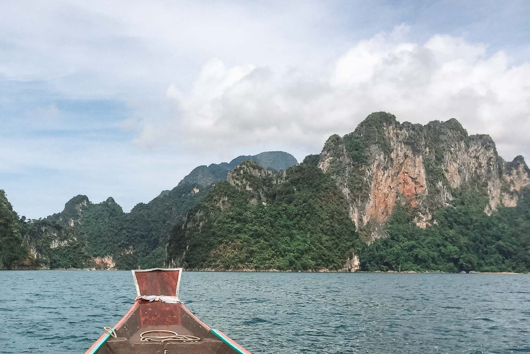 Boat on water at Khao Sok National Park in Thailand - bucket list travel