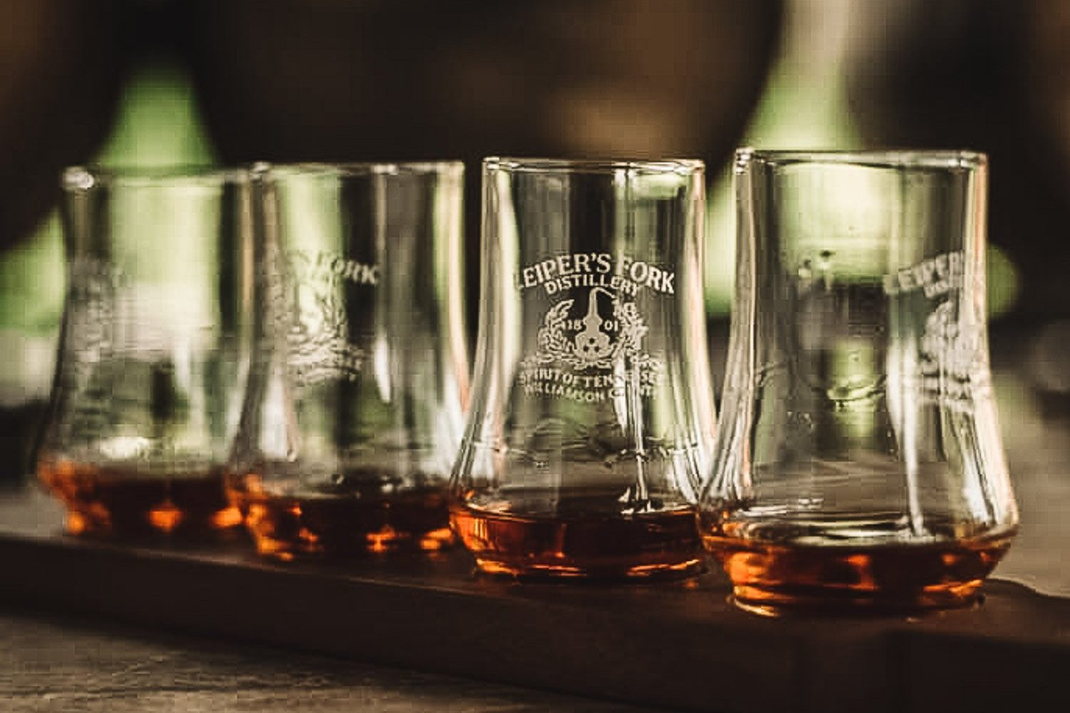 One of the fun things to do in Leiper's Fork, Tennessee is visit the Leiper's Fork Distillery. Here are four glasses filled with some whiskey.