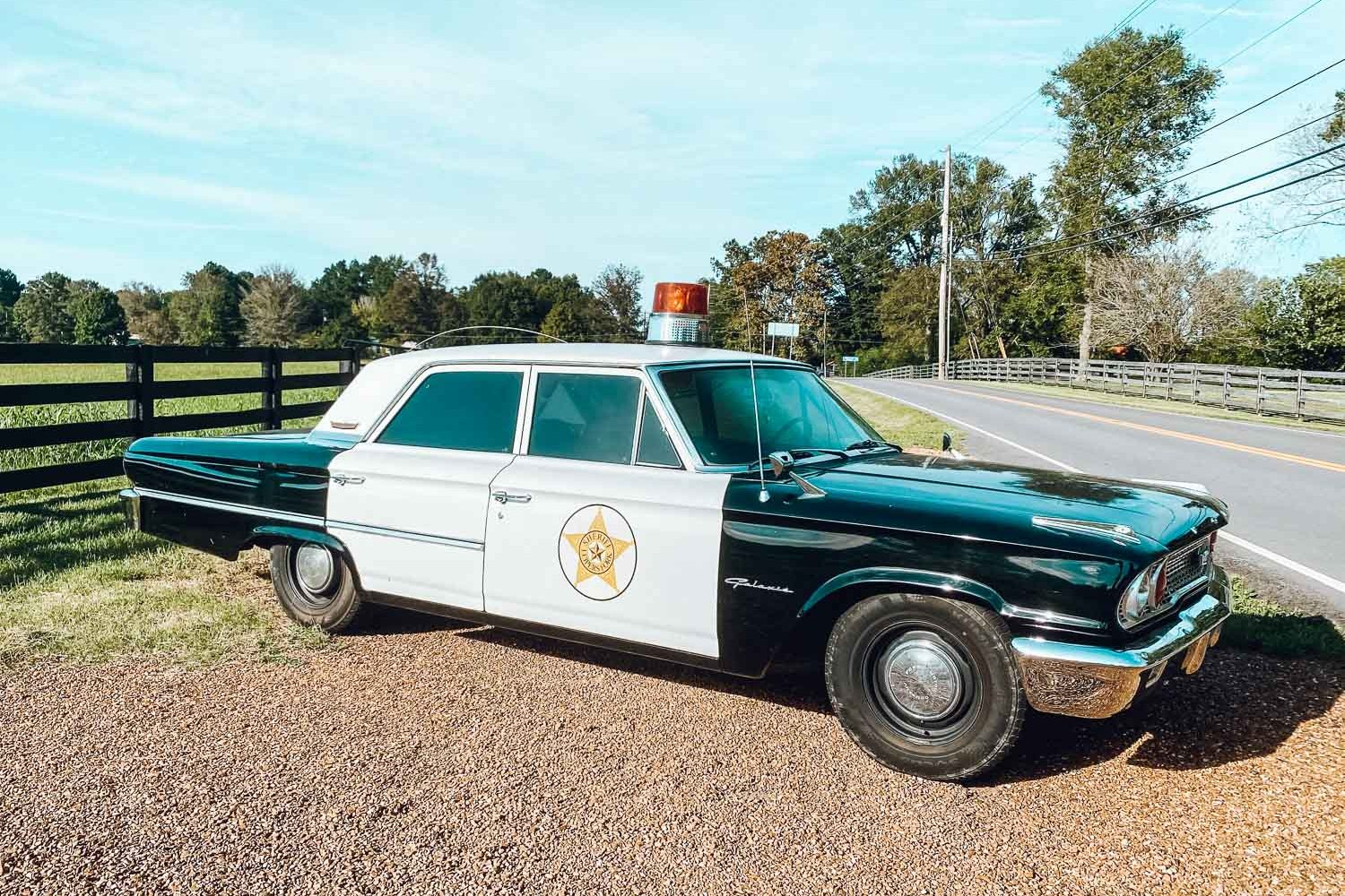 Things to do in Leiper's Fork - An old-fashioned cop car sitting on the side of the road - bucket list travel