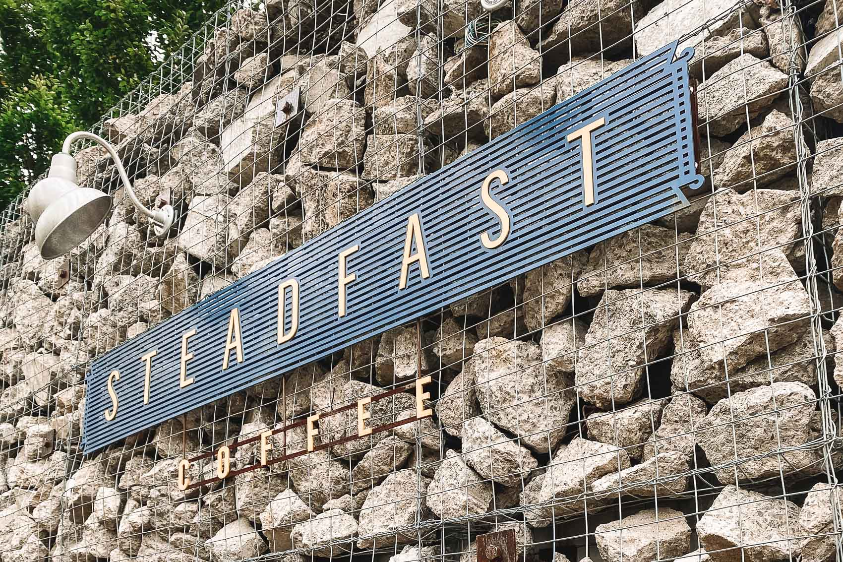 Sign that reads Steadfast Coffee, a shop located in Germantown in Nashville, TN - bucket list travel